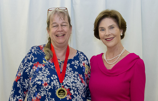 Author Julie Williams (A Rare Titanic Family) and former First Lady Laura Bush, winners of the Ella Dickey Literacy Award at the 2014 Cherry Blossom Festival in Marshfield, Mo.
