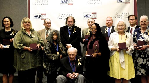 At the Alabama Writers Hall of Fame induction ceremony, from left: Cathy Randall (for Harper Lee); Keller Johnson Thompson (for Helen Keller); Bert Hitchcock (for Johnson Jones Hooper); Sonia Sanchez; Andrew Glaze; Rick Bragg; John Jeter (for Sena Jeter Naslund); Valerie Boyd (for Zora Neale Hurston); Paul Devlin (for Albert Murray); Kathleen Thompson (for Helen Norris Bell); Edward Russell March III (for William March); Mary Lou Meaher (for Augusta Jane Evans Wilson). Photo by Elizabeth Wyngarden Limbaugh.