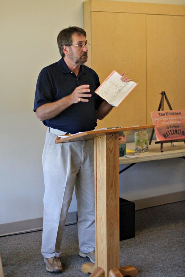 Ted Dunagan speaks at the Orange Beach Public Library (Rachel Bobo)
